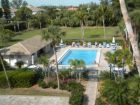 Beach front vacation condo with communal pool in Sanibel Island, Florida