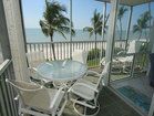 Screened balcony with outdoor furniture