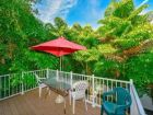 large deck in Anna Maria Island Rental over looking greenery