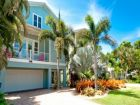 Exterior of Rental home with Landscaped Front Entrance and Palms