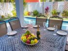 Outdoor Dining Table Next to Pool
