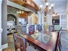 Luxury Kitchen with High End Appliances & Dining Area