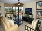 Living room with large wall-mount flat screen cable television