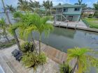 Stunning 4 Bedroom Canal front Vacation  Home with Pool