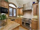 Well Stocked Kitchen with Granite Counter Tops