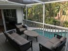 Outdoor Furniture on Deck Overlooking Pool
